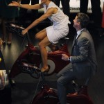 Denmark's Crown Princess Mary and Crown Prince Frederick ride stationary bicycles to generate power for making drinks at an exhibition in Sydney